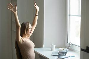 Profile portrait of a woman celebrating writing a blog post